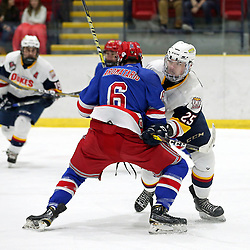 WELLINGTON, ON - JANUARY 25: Dylan Massie #25 of the Wellington Dukes battles for position with Nicholas Aromatario #6 of the Oakville Blades on January 25, 2019 at Wellington and District Community Centre in Wellington, Ontario, Canada.<br /> (Photo by Ed McPherson / OJHL Images)