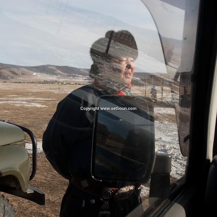 Mongolia. man near a russian jeep in the steppe near  Avrakaer (Ovokhangai)