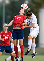 Liberty Flames midfielder Maggie Woody (15) wins a header from Virginia Cavaliers midfielder/forward Kelly Quinn (10).  The Virginia Cavaliers defeated the Liberty Flames 5-0 in women's soccer at Klockner Stadium on the Grounds of the University of Virginia in Charlottesville, VA on August 29, 2008.