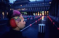 Buren Column in palais royal  Paris  France    / coiffure sculpture du coiffeur plasticien Jean Philippe Pages un modele devant les Colonnes de Buren au palais royal  Paris  France