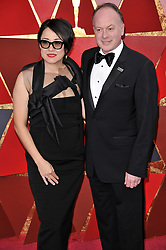 Ramsey Ann Naito and Tom McGrath walking on the red carpet during the 90th Academy Awards ceremony, presented by the Academy of Motion Picture Arts and Sciences, held at the Dolby Theatre in Hollywood, California on March 4, 2018. (Photo by Sthanlee Mirador/Sipa USA)