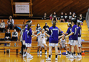 Amherst College's Marley Giddins (4) is introduced in the starting line up at the start of a game against Hamilton College, Friday, Jan. 9, 2015, in Amherst, Mass.  Amherst has broken UConn's women's NCAA record with 104 consecutive home victories and is closing in on the Kentucky men's record of 120-plus wins set decades ago. (Jessica Hill for the New York Times)