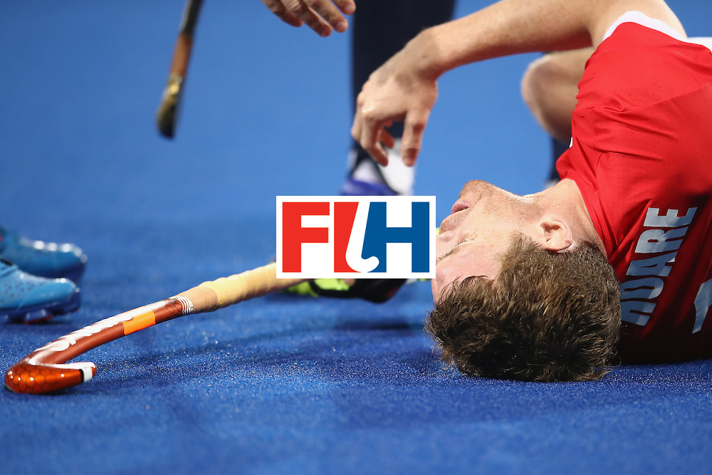 RIO DE JANEIRO, BRAZIL - AUGUST 10:  Michael Hoare of Great Britain lies injured on the ground during the men's pool A match between Great Britain and Australia on Day 5 of the Rio 2016 Olympic Games at the Olympic Hockey Centre on August 10, 2016 in Rio de Janeiro, Brazil.  (Photo by Mark Kolbe/Getty Images)