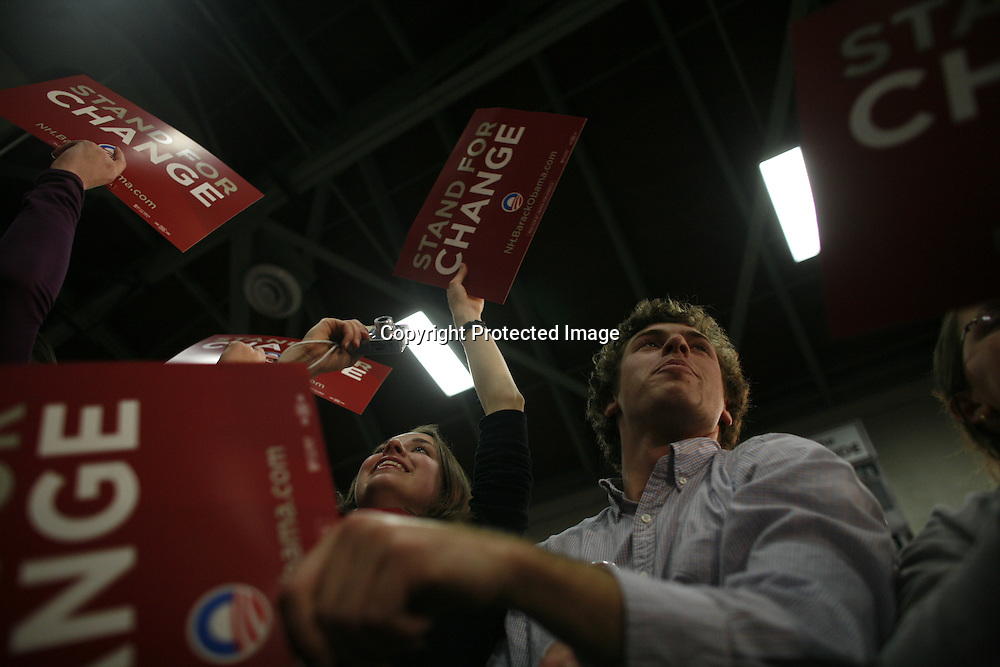 Supporters cheer as U.S. Democratic Presidential candidate Senator Barack Obama (D-IL) speaks during a campaign stop in Concord, New Hampshire January 6, 2008.