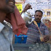 A chai wala near the train station in Raipur, Chhattisgarh. January 2007