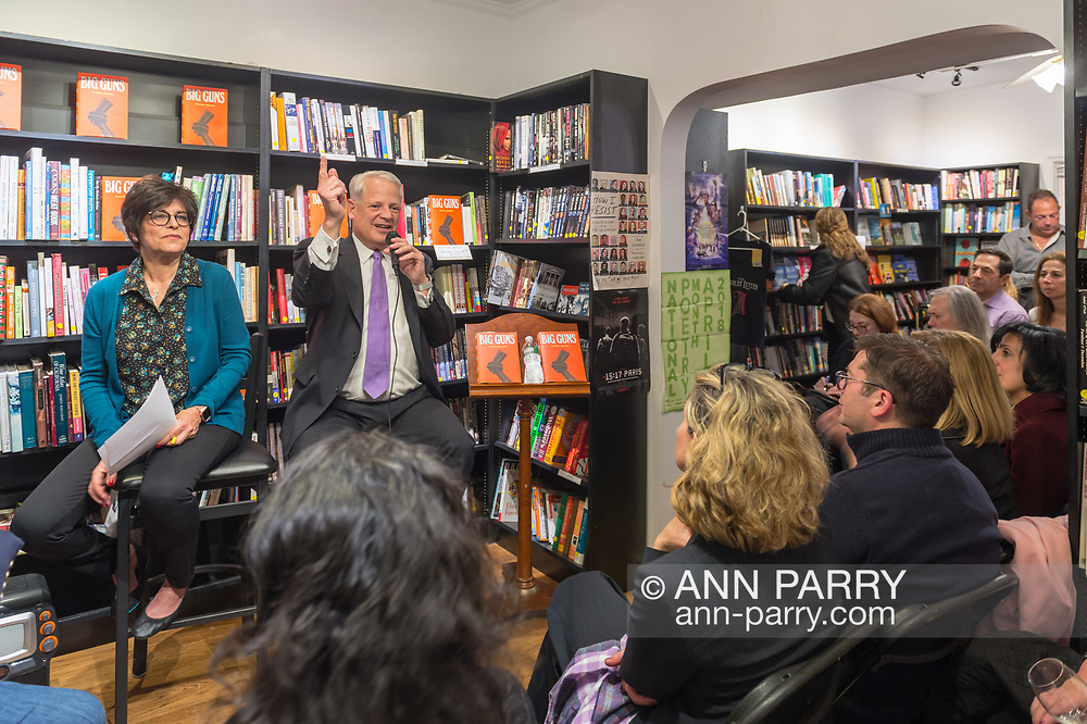 Rockville Centre, New York, USA. April 201, 2018. Sitting facing audience, Rep. STEVE ISRAEL speaks at special event for the former Congressman's newest novel BIG GUNS, at Turn of the Corkscrew Books & Wine. Sitting left of Israel is Moderator RITA KESTENBAUM.