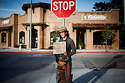 """Monterey, April 4 2012 - Stephanie, 22, a young Canadian woman hitch-hiking and beging for money, on her way from Canada to Mexico. She brought the novel """"On the Road"""" by Jack Kerouac in her bag."""