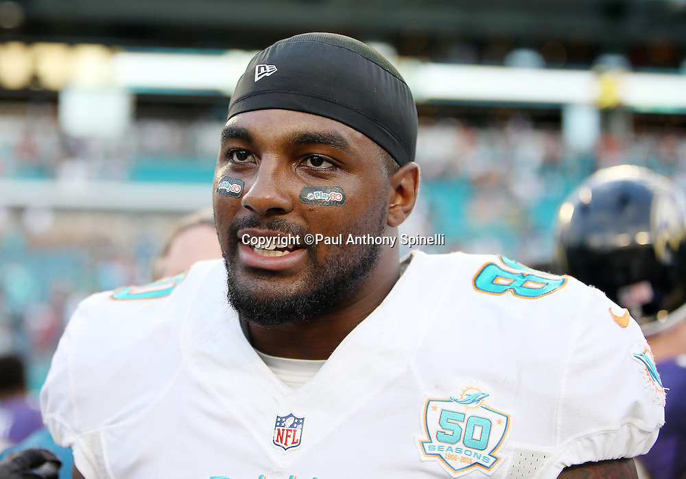 Miami Dolphins tight end Dion Sims (80) looks on from the sideline during the 2015 week 13 regular season NFL football game against the Baltimore Ravens on Sunday, Dec. 6, 2015 in Miami Gardens, Fla. The Dolphins won the game 15-13. (©Paul Anthony Spinelli)