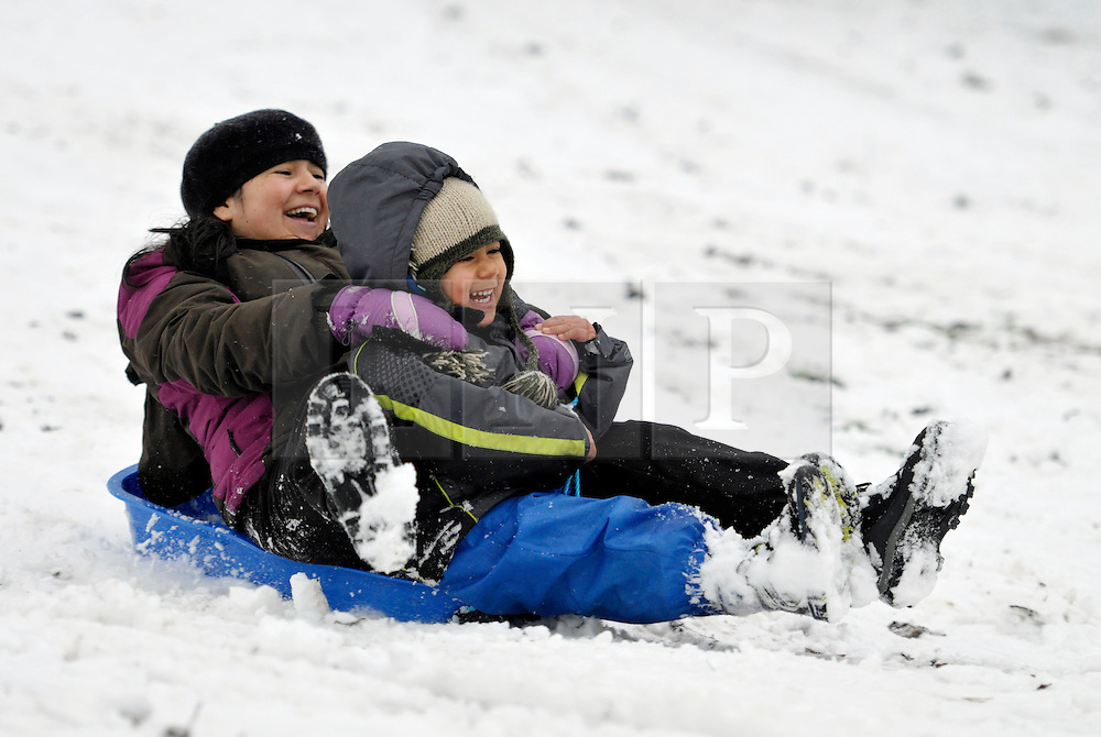 © Licensed to London News Pictures. 18/01/2013. Bristol, UK. Heavy snow provides a winter playground for people to enjoy sledging and tobogganing at Brandon Hill in central Bristol. 18 January 2013..Photo credit : Simon Chapman/LNP