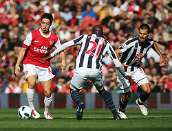 25.09.2010, Emirates Stadium, London, ENG, PL, Arsenal vs west Bromwich Albion, im Bild Arsenal's Samir Nasri takes on West Brom's Youssouf Malumba, EXPA Pictures © 2010, PhotoCredit: EXPA/ IPS/ Mark Greenwood *** ATTENTION *** UK AND FRANCE OUT! / SPORTIDA PHOTO AGENCY