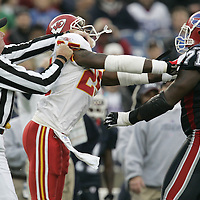 Head Linesman Ed Camp(left) tries to restrain Kansas City Chiefs safety #25 Greg Wesley from fighting with Buffalo Bills offensive linesman #71 Jason Peters during the fourth quarter at Ralph Wilson Stadium. The Buffalo Bills beat the Kansas City Chiefs 14-3.