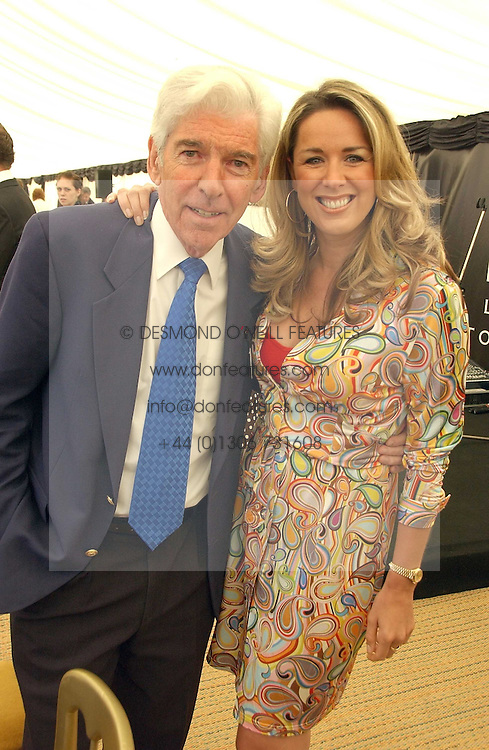 TOM O'CONNOR and CLAIRE SWEENEY at the Kuoni World Class Polo Day at Hurtwood Park Polo Club, Surrey on 28th May 2006.<br />