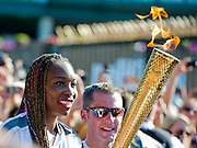 Venus Williams  runs the first leg of the Olympic Torch relay after the All England Lawn Tennis Club stop at Wimbledon, London, UK, 23 July 2012.