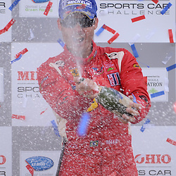 7 August, 2010; JAIME MELO sprays champagne to celebrate winning the GT category in the American LeMans Series Mid-Ohio Sports Car Challenge at the Mid-Ohio Sports Car Course in Lexington, Ohio..Mandatory Credit: Will Schneekloth / Southcreek Global