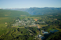 Aerial perspectives of the city of Cumberland and its proximity to Comox Lake demonstrate the large amount of recreational green space that surrounds the community.  Cumberland, Vancouver Island, British Columbia, Canada.
