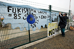 © Licensed to London News Pictures. 08/10/2012. Hinkley Point, Somerset, UK. Anti-nuclear campaigners hold a mass trespass protest at the site of Hinkley Point nuclear power station.  Energy company EDF plans to build a new nuclear power plant at the site called Hinkley C.  08 October 2012..Photo credit : Simon Chapman/LNP