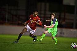 ALTRINGHAM, ENGLAND - Friday, March 10, 2017: Liverpool's Glen McAuley in action against Manchester United's Tyrell Warren during an Under-18 FA Premier League Merit Group A match at Moss Lane. (Pic by David Rawcliffe/Propaganda)