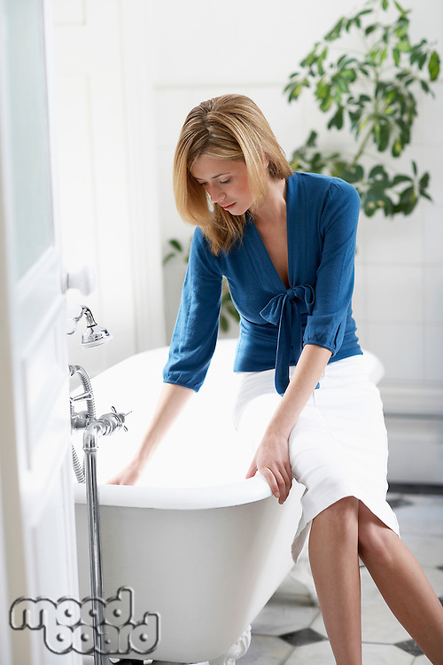 Businesswoman Filling Bathtub