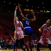 24 February 2018: The San Diego State women's basketball team closes out it's home schedule of the regular season Saturday afternoon against San Jose State. San Diego State Aztecs guard Khalia Lark (1) attempts  shot in the paint while being defended by San Jose State Spartans forward Mikaylah Wilson (32) in the first half. At halftime the Aztecs lead the Spartans 36-33 at Viejas Arena.<br /> More game action at sdsuaztecphotos.com