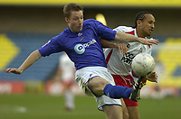 Photo: Matt Bright/Sportsbeat Images.<br /> Millwall v AFC Bournemouth. The FA Cup. 01/12/2007.<br /> Neil Harris of Millwall &  Joshua Gowling of Bournemouth