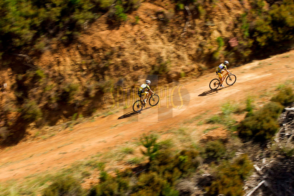 LOURENSFORD - Overall winners Jaroslav Kulhavy & Christoph Sauser of Burry Stander-Songo during the final stage (stage 7) of the 2013 Absa Cape Epic Mountain Bike stage race from Stellenbosch to Lourensford Wine Estate in Somerset West, South Africa on the 24 March 2013..Photo by Gary Perkin/Cape Epic/SPORTZPICS