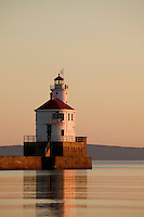 WI00174-00...WISCONSIN - Sunrise at Wisconsin Point Lighthouse on Lake Superior near the town of Superior.
