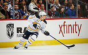 SHOT 2/25/17 9:38:28 PM - The Buffalo Sabres' Tyler Ennis #63 looks to pass against the Colorado Avalanche  during their NHL regular season game at the Pepsi Center in Denver, Co. The Avalanche won the game 5-3. (Photo by Marc Piscotty / © 2017)