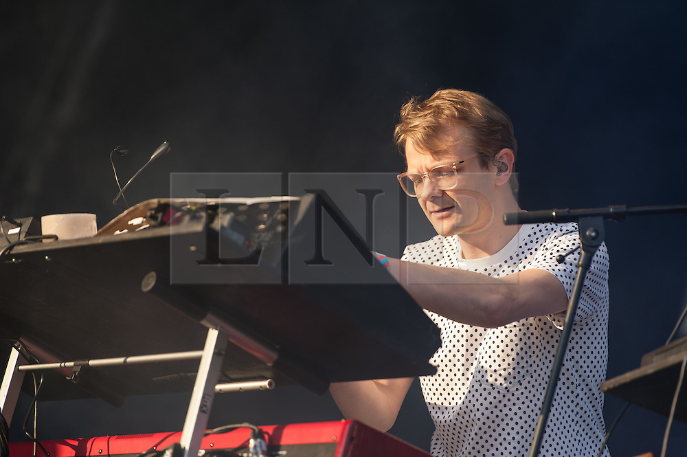 © Licensed to London News Pictures. 06/06/2015. London, UK.   Django Django performing live at Field Day Festival Saturday Day 1.  In this picture - Tommy Grace.  Django Django are a British art rock band composed of members  David Maclean (drummer and producer), Vincent Neff (singer and guitarist), Jimmy Dixon (bassist), and Tommy Grace (synthesizer)    Photo credit : Richard Isaac/LNP