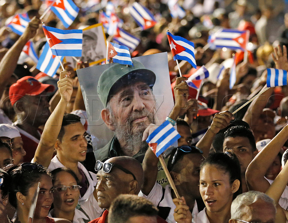 Cubans wait for the arrival of Fidel Castro's ashes during his memorial service at the Antonio Maceo Plaza Revolucion, in Santiago de Cuba on Saturday, December 3, 2016.