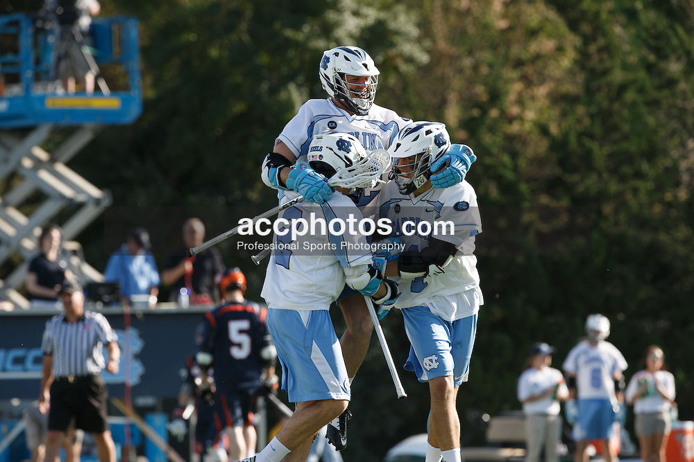 CHAPEL HILL, NC - APRIL 11: Duncan Hutchins #32 jumps into the arms of Patrick Kelly #2 (L) and Luke Goldstock #1 (L) of the North Carolina Tar Heels after scoring against the Syracuse Orange on April 11, 2015 at Fetzer Field in Chapel Hill, North Carolina. North Carolina won 17-15. (Photo by Peyton Williams/US Lacrosse/Getty Images) *** Local Caption *** Patrick Kelly;Duncan Hutchins;Luke Goldstock