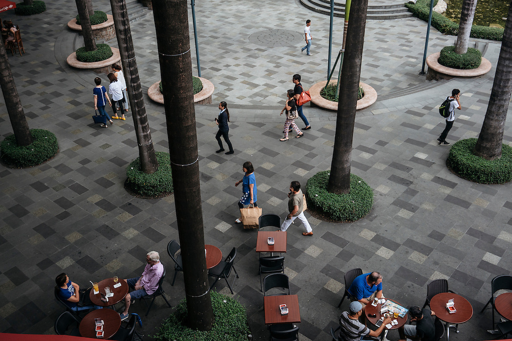 Patrons sit outside the Havana Cafe at the Greenbelt Mall, an upscale mall in Makati City, part of metro Manila, Philippines.