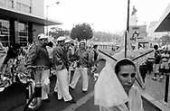 Woman and members of the band of Bica's march waiting for the beggining of the parade on the top of Liberdade Avenue.