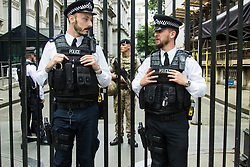Downing Street, London, May 24th 2017. Armed soldiers join the police guarding Downing Street as Prime Minister Theresa May up grades the terror alert to 'Critical'.