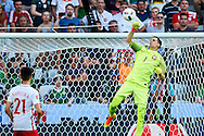 Nice, France - 2016 June 12: Goalkeeper Wojciech Szczesny of Poland saves while Poland v Northern Ireland during Soccer European Championships UEFA EURO 2016 at Stadium Nice on June 12, 2016 in Nice, France.<br /> <br /> Adam Nurkiewicz declares that he has no rights to the image of people at the photographs of his authorship.<br /> <br /> Picture also available in RAW (NEF) or TIFF format on special request.<br /> <br /> Any editorial, commercial or promotional use requires written permission from the author of image.<br /> <br /> Mandatory credit:<br /> Photo by © Adam Nurkiewicz