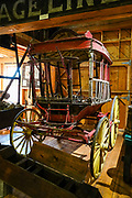 The Omni Bus, built in 1830,  later carried passengers to and from the railroad depot in 1880s Silverton. San Juan County Historical Society Museum, Silverton, Colorado, USA. Silverton is a former silver mining camp, now the federally-designated Silverton Historic District. Durango is linked to Silverton by the Durango and Silverton Narrow Gauge Railroad, a National Historic Landmark. Silverton no longer has active mining, but subsists on tourism, maintenance of US 550 (which links Montrose with Durango), mine pollution remediation, and retirees.