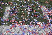 Red, white, and blue confetti lies on the turf after the New England Patriots NFL Super Bowl 53 football game against the Los Angeles Rams on Sunday, Feb. 3, 2019, in Atlanta. The Patriots defeated the Rams 13-3. (©Paul Anthony Spinelli)