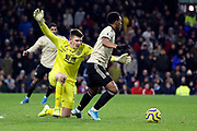 Burnley goalkeeper Nick Pope (1) blocks the progress of Manchester United forward Anthony Martial (9) during the Premier League match between Burnley and Manchester United at Turf Moor, Burnley, England on 28 December 2019.