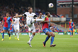 Swansea City's Angel Rangel clears the ball from Crystal Palace's Cameron Jerome - Photo mandatory by-line: Robin White/JMP - Tel: Mobile: 07966 386802 22/09/2013 - SPORT - FOOTBALL - Selhurst Park - London - Crystal Palace V Swansea City - Barclays Premier League
