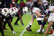 Denver Broncos center Matt Paradis (61) gets set at the line of scrimmage as the Denver Broncos offensive line lines up opposite the Arizona Cardinals defensive line during the NFL week 7 regular season football game against the Arizona Cardinals on Thursday, Oct. 18, 2018 in Glendale, Ariz. The Broncos won the game 45-10. (©Paul Anthony Spinelli)