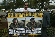 A protester displays protest signs depicting the Bush twins as the models for an Army recruiting advertisement the anti-war march on Washington.