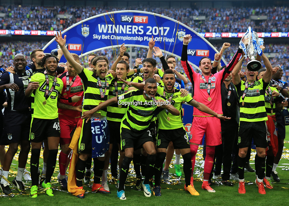 May 29th 2017, Wembley Stadium, London, England; EFL Championship playoff final, Huddersfield Town versus Reading; Jonathan Hogg of Huddersfield Town lifts the EFL Championship playoff final trophy with his players as they celebrate towards the Huddersfield Town fans