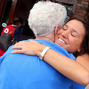 Rachael Gallelli, girlfriend of Michael Parrish hugs Parrish's grandmother June Parrish Saturday November 2, 2013 at Carrabba's Italian Grill in Wilmington, N.C. Parrish was in town with Michael's parents David and Joanne who have not seen their son play soccer since David's 2011 injury that left him paralyzed. (Jason A. Frizzelle)