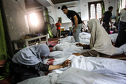 0360150  <br /> Egyptian women mourn over their dead relative in Al-Eman mosque, where 361 protester s bodies lay in lines, in Cairo s Nasr City, Egypt, Thursday Aug. 15, 2013. At least 421 were killed and 3,572 others injured across Egypt in clashes between supporters of ousted President Mohamed Morsi and the security troops, after the latter dispersed Wednesday two pro-Morsi sit-ins in the country, the Health Ministry said on Thursday.<br /> Picture by imago / i-Images<br /> UK ONLY