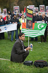 Campaigners marched down the Royal Mile in Edinburgh waving placards, banners and Kashmir flags to highlight calls for independence for the disputed region of Kashmir. They then held a rally outside the Scottish Parliament.<br /> <br /> &copy; Dave Johnston/ EEm
