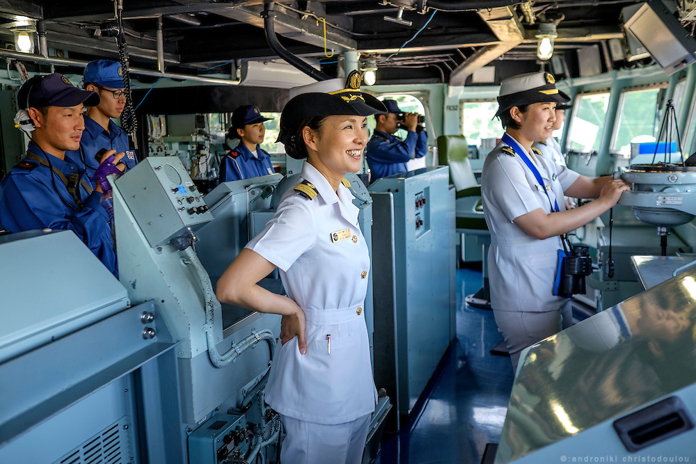 Miho Ootani, the first woman destroyer captain of Japan's Marine Self Defence Forces (MSDF), on board the Yamagiri in Yokosuka army base near Tokyo. While performing her duties, she has to spend most of her time on the bridge together with other officers and crew members.