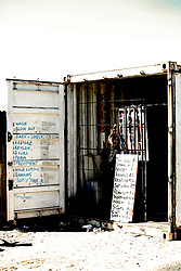 Hair stylist works out of a container, Khayelitsha, Cape Town