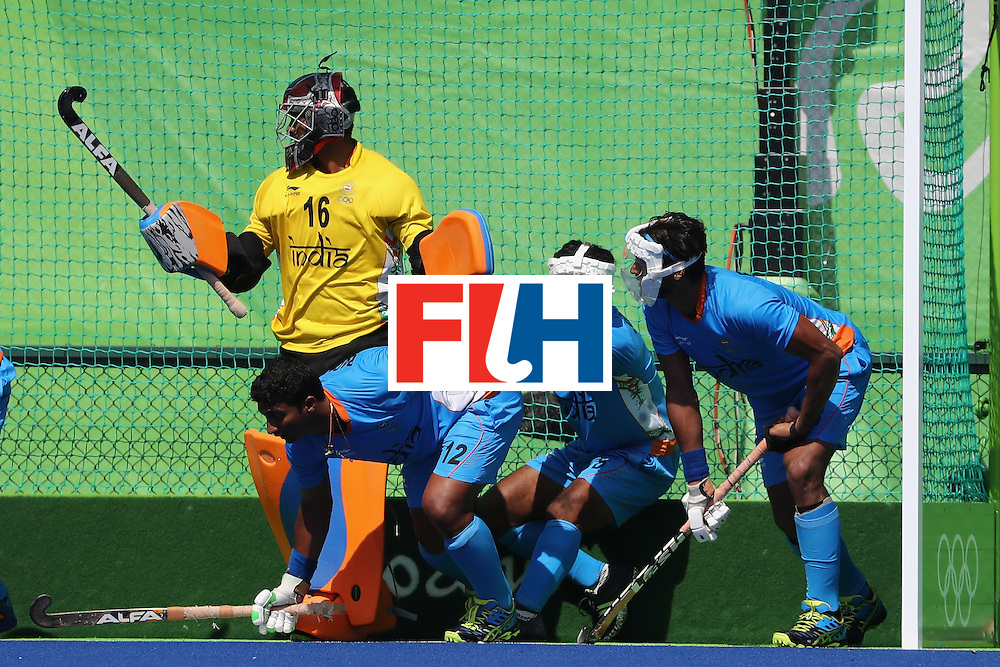 RIO DE JANEIRO, BRAZIL - AUGUST 06:  Sreejesh Parattu #16, Raghunath Vokkaliga #12, and Sardar Singh #8 of India defend during a Pool B match between Ireland and India on Day 1 of the Rio 2016 Olympic Games at the Olympic Hockey Centre on August 6, 2016 in Rio de Janeiro, Brazil.  (Photo by Sean M. Haffey/Getty Images)