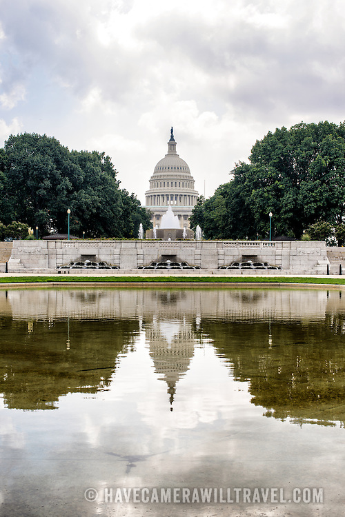 The dome of the U.S. Capitol building is reflected on the Senate Reflecting Pool on the north side of Capitol Hill.