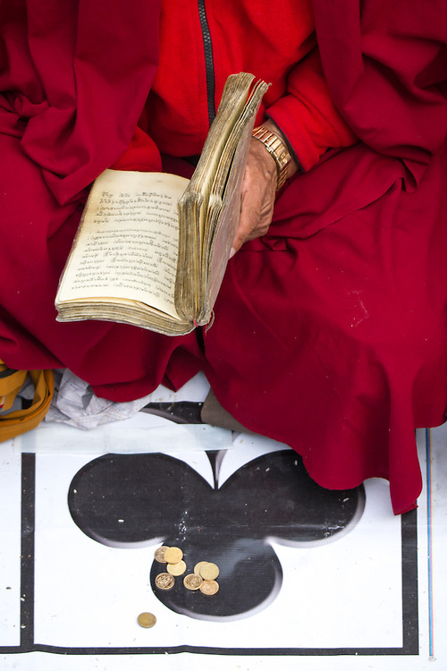 Licensed by Getty Images (2012). Available here: http://www.gettyimages.com/detail/photo/buddhist-monk-ace-of-clubs-small-change-royalty-free-image/159321443