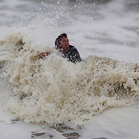 (PPAGE1) Manasquan 10/25/2005 Surfer Dale Collins 23 of Sea Isle City tries his best to make it past the breakers so he can surf the big waves in Manasquan.  He was at inlet beach.  Michael J. Treola Staff Photographer....MJT